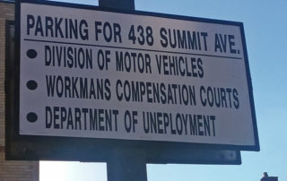 Parking lot sign with obvious typos
