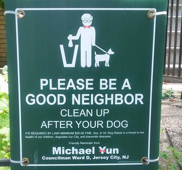 Sign that says Please be a good neighbor. Clean up after your dog.
