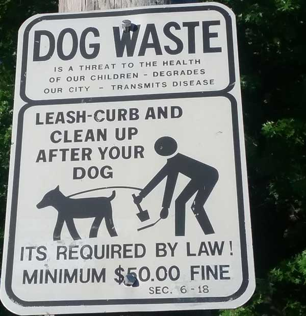 Sign DOG WASTE is a threat to the health of our children...Leash-curb and clean up after your dog, Its required by law, minimum $50.00 fine