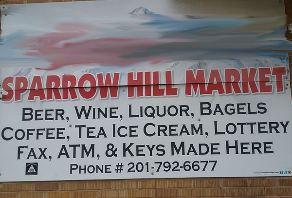 """Photo of liquor store sign with a long list of products ending """"ATM, & Keys Made Here"""""""